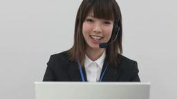Woman talking on intercom Footage