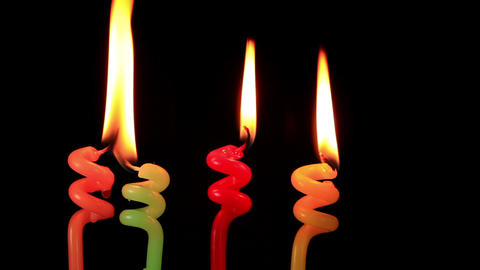 Candles on a Birthday cake burning down, time lapse Footage