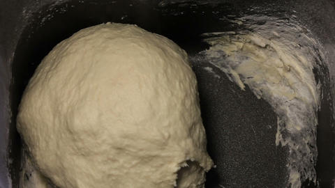 Dough for bread in bread maker, timelapse Stock Video Footage