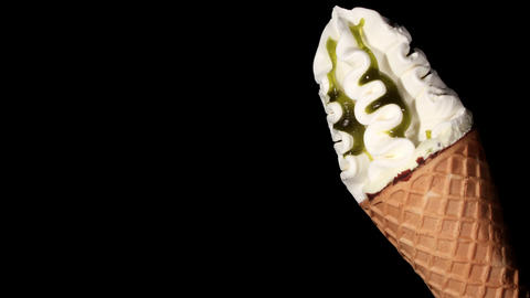 Time-lapse melting ice cream on the black background Stock Video Footage