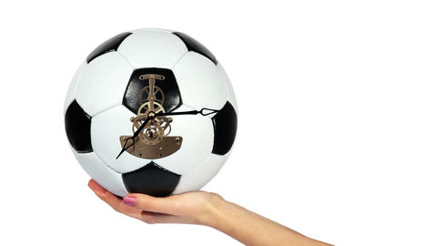 Soccer Ball Clock on the hand, on the white background,... Stock Video Footage