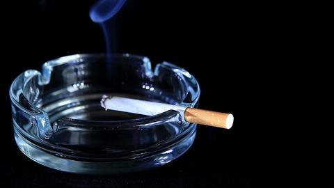 Smoldering Cigarette on the black background, Timelapse Stock Video Footage