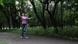 Boy and girl playing in badminton Footage