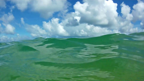 Waves in open sea and blue sky with clouds Stock Video Footage