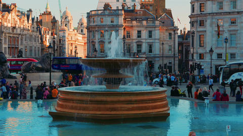 Trafalgar Square Timelapse of tourists and buses passing by Footage