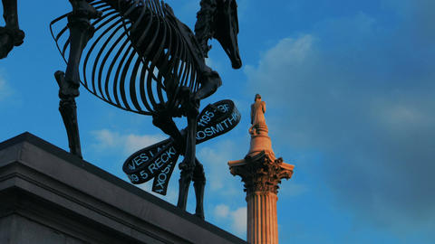 London Stock Exchange Ticker In Trafalgar Square Against White Clouds stock footage