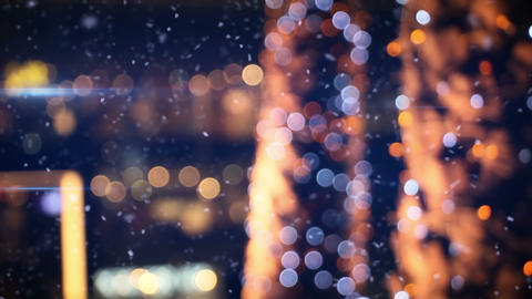 defocused christmas lights in wintry city Footage