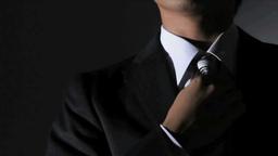 Businessman fastening a tie Footage