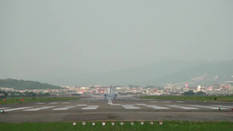 A plane landing at Song Shan Airport, Taipei, Taiwan Footage