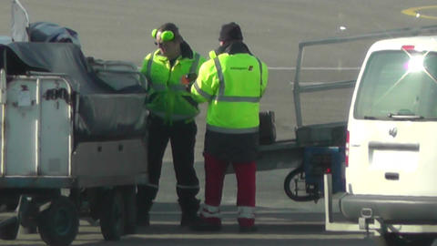 Airport Staff working handheld Stock Video Footage