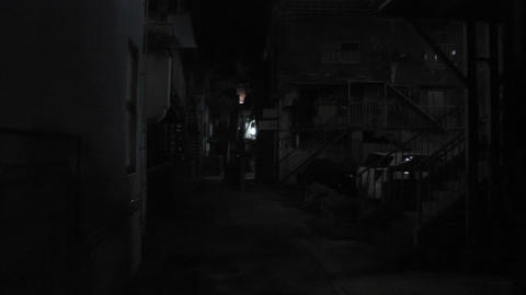 Dark Alley with Scary Face showing up handheld Stock Video Footage