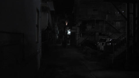 Dark Alley with Scary Face showing up handheld Footage