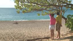 Couple looking at sea in Honolulu Hawaii Footage