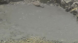 Hot Water Bubbling On Ground In Tateyama, Japan stock footage