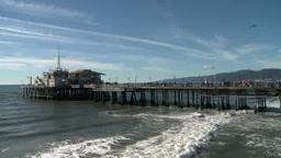Waves rush under pier in Santa Monica Footage