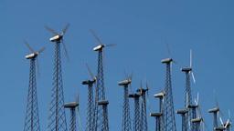 A Row Of Wind Turbines Rotate On A Wind Farm stock footage