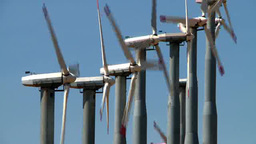 A Row Of Wind Turbines Rotate On A Wind Farm stock footage
