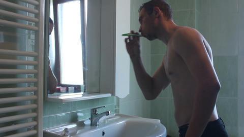 man washing his teeth Footage