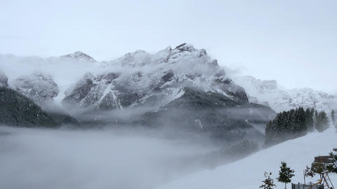Pan Tilt Summit To Prags Valley Fog Snow 11690 stock footage