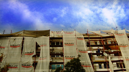 Bucharest, Romania - October 2015.Construction workers on scaffolding repairing  Footage