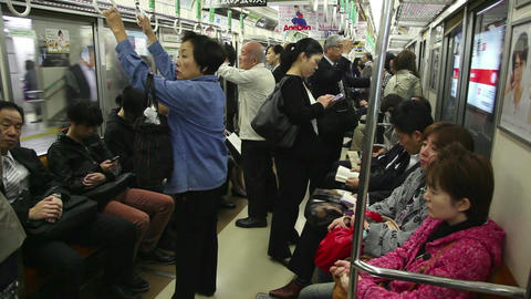 2of 10 Japanese people , commuters traveling , subway train , Osaka , Japan , As Footage