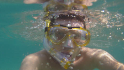 Tourists dive with mask Stock Video Footage