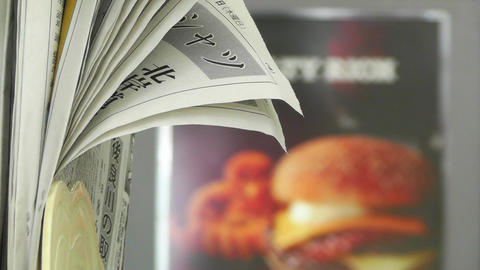 Japanese Newspaper in Burger Restaurant Stock Video Footage