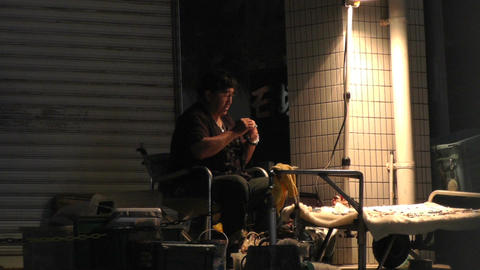 Okinawa Islands Street at Night 05 street artist handheld 60fps native slowmotion Footage