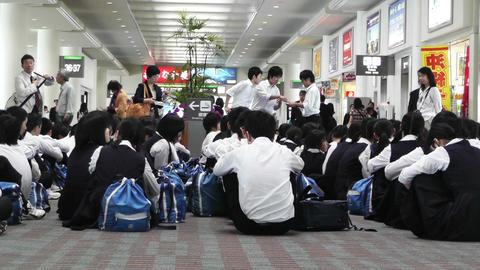 Okinawa Naha Airport Terminal 09 children waiting Stock Video Footage