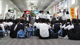 Okinawa Naha Airport Terminal 09 children waiting Stock Video Footage