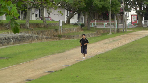 Park in Okinawa Islands 04 running boy Footage
