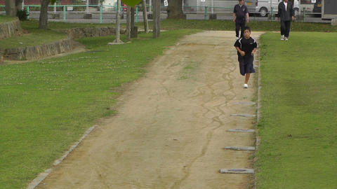 Park in Okinawa Islands 05 running boy 60fps native... Stock Video Footage