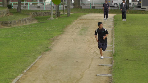 Park in Okinawa Islands 05 running boy 60fps native slowmotion Footage