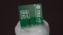 Close Up of a Chinese Bank Card Frozen in Ice Footage