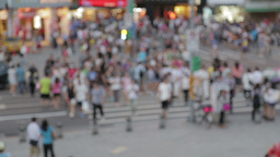 Out of focus crowds crossing pedestrian crossing Live Action