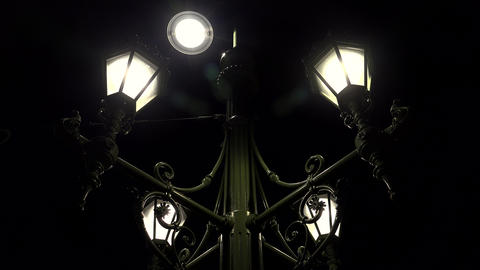 Street lamp lit at night. 4K Live Action