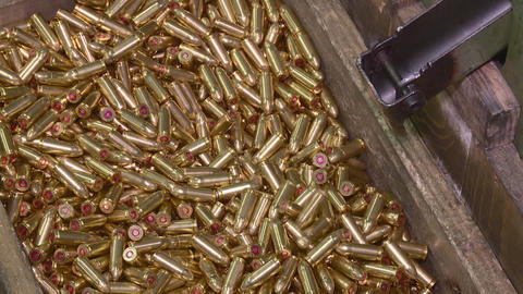 Factory of ammunition, bullets for rifle on production line Live Action