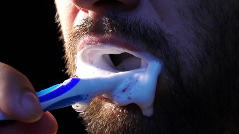 man brushing his teeth slow motion Footage