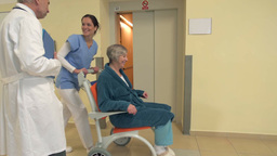 Nurse With Patient In Wheelchair Coming Out Of Hospital Lift stock footage