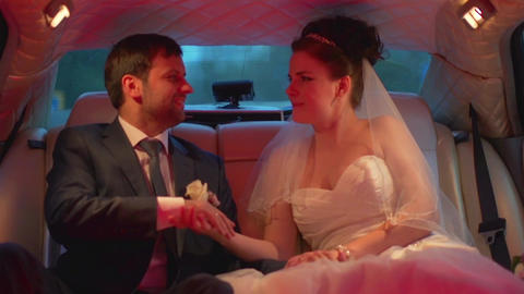European wedding, the bride and groom kissing in limo Footage
