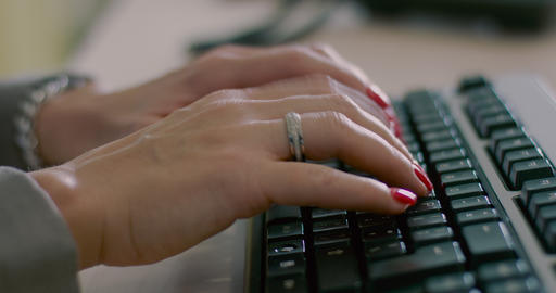 Women's hands typing on computer keyboard Footage