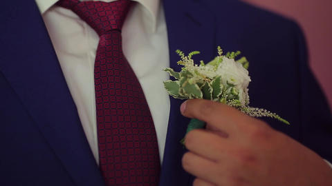 the groom corrects a buttonhole Footage