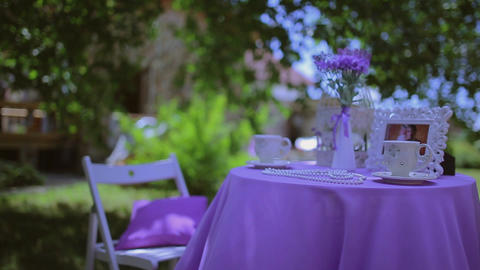 Violet Little Table In The Yard Tea Drinking stock footage