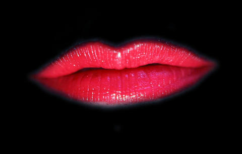 Red Lips Kissing On A Black Background stock footage