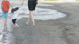 Mother walking along a beach Footage