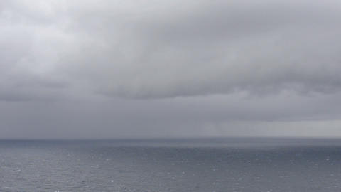 Ocean landscape with clouds and rain Footage