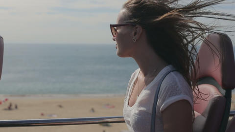 Young beatiful woman traveling thruought coastline with beach and ocean by touri Footage