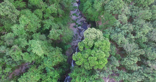 moving birds eye over Huay Kaew waterfalls Footage