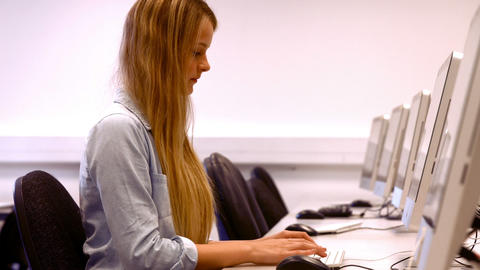 Happy student working on a pc Footage