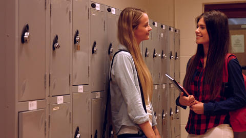 Two happy students chatting to each other Footage